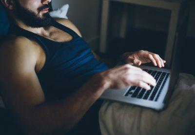 sexy-man-working-on-laptop
